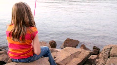 Little girl fishing Stock Footage