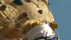 fitness, youth on climbing wall - stock footage