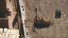 Log lift off wharf and into ship Stock Footage