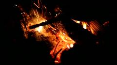 Stock Video Footage of Night. Bonfire. Stir hot coals.