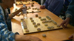 Men playing chinese backgammon, #1 Stock Footage