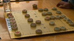 Men playing chinese backgammon, #3 close up Stock Footage