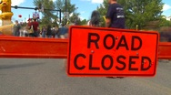 Time-lapse, road closed sign and people Stock Footage