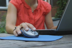 Young woman uses laptop outside.SD. Stock Footage