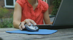 Young woman uses laptop outside. Stock Footage
