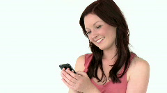 Happy young woman writing a message on her cellphone Stock Footage