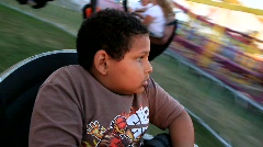 Scared Boy on Carnival Ride (HD) c Stock Footage