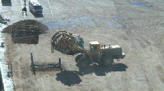 Logs being prepared for loading onto a ship Stock Footage