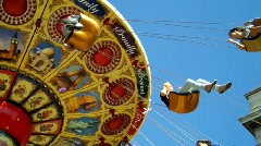 Low Angle shot of People on Fair Ground Ride against Blue Sky, feat music Stock Footage