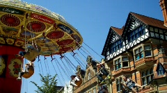 Fair Ground Ride, People in Swings, Historic building in background Stock Footage
