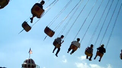 Fair Ground Ride, People in Swings against blue sky Stock Footage