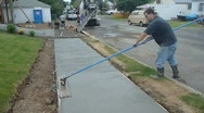 Stock Video Footage of Sidewalk Construction 1