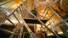 Workers assembles erecting ladder in orthodox cathedral Stock Footage