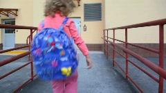 Little girl using door intercommunication system Stock Footage