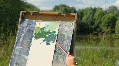 Hands of adult man and girl painting landscape Stock Footage