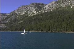 Lake Shore Sailboat-zoom Stock Footage