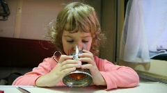Girl drinking tea from glass with glass holder in coach Stock Footage