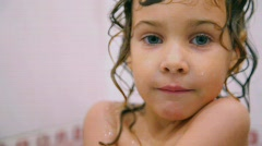 portrait of cute girl in bathroom - stock footage