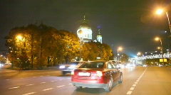 Driving car in night past the Cathedral of the Redeemer Stock Footage