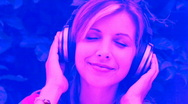 Stock Video Footage of Young woman listens to music. Pink and blue.