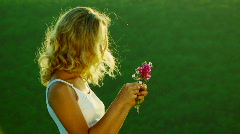 The girl plucks petals Stock Footage