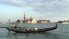 Venice gondola with people passing San Marco square Stock Footage