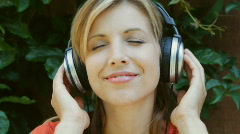 Young woman listens to music. Upbeat. Stock Footage