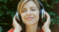 Stock Video Footage of Young woman listens to music. Upbeat.