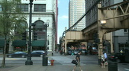 Stock Video Footage of Traffic passes beneath Chicago's L (1 of 2)