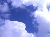 Motion background - white clouds flying on blue sky Stock Footage