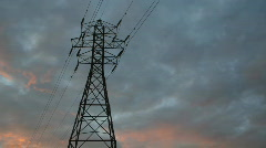 Electrical pylon. Sunset timlepse clouds. Stock Footage