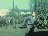 Pre-Teen Boy plays catch football in suburban backyard Stock Footage