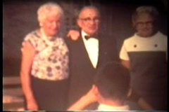 Grandparents pose for portrat picture by grandson - stock footage