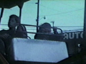 Brothers ride roller coaster at carnival Stock Footage