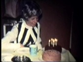 Woman can't blow out trick gag birthday candles Stock Footage