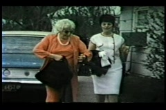 Glam 60's mom with Bouffant and Family leave for formal event Stock Footage