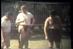 Family & little boy play Croquet in backyard Stock Footage