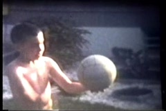 :30 seconds of Released little boy playing volleyball - stock footage