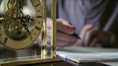 ticking clock with man making notes - stock footage