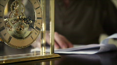 ticking clock with paperwork - stock footage
