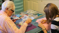 Family Makes Jewelry Stock Footage