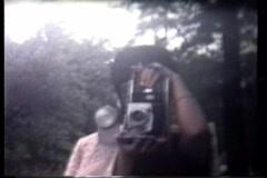 Family with Polaroid camera Stock Footage