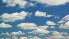 White clouds moving over blue sky Stock Footage