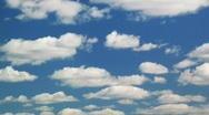 Stock Video Footage of White clouds moving over blue sky