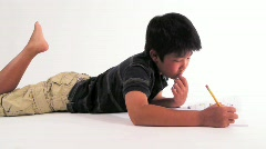 Little Boy Doing Homework Stock Footage