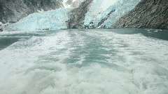 Boat cruising away from glacier P HD 8355 Stock Footage
