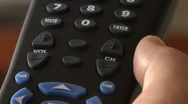 Man preses Channel Up & Down buttons on TV remote control Stock Footage