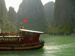 Ha Long Bay Monoliths an tour boat in Vietnam Stock Footage