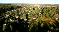 Fly above village and forest Stock Footage