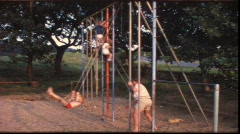 Monkey bars and swing (vintage 8 mm amateur film) Stock Footage